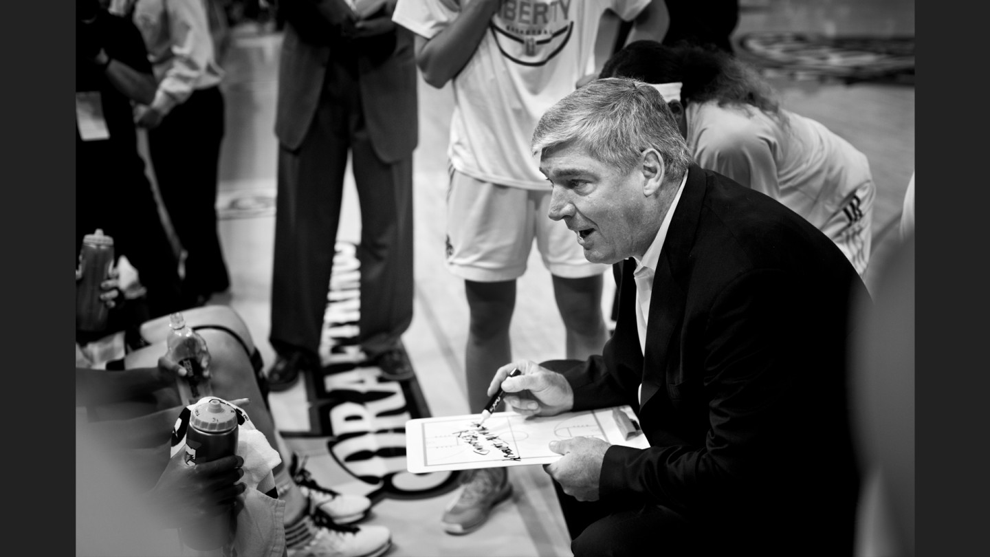 Coach Bill Laimbeer talks with the team during a timeout.