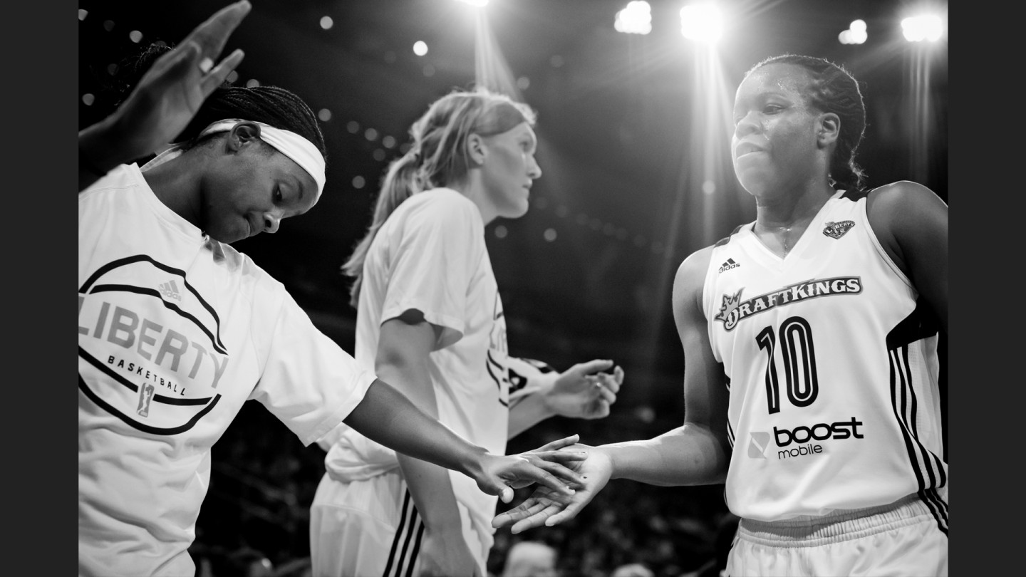 Sugar Rodgers high-fives Epiphanny Prince as the Liberty take on the Lynx .