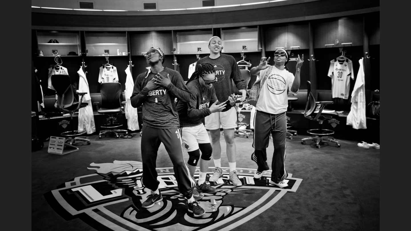 Swin Cash (not pictured) records Essence Carson, Brittany Boyd, Kiah Stokes and Sugar Rodgers for a team music video in the locker room.