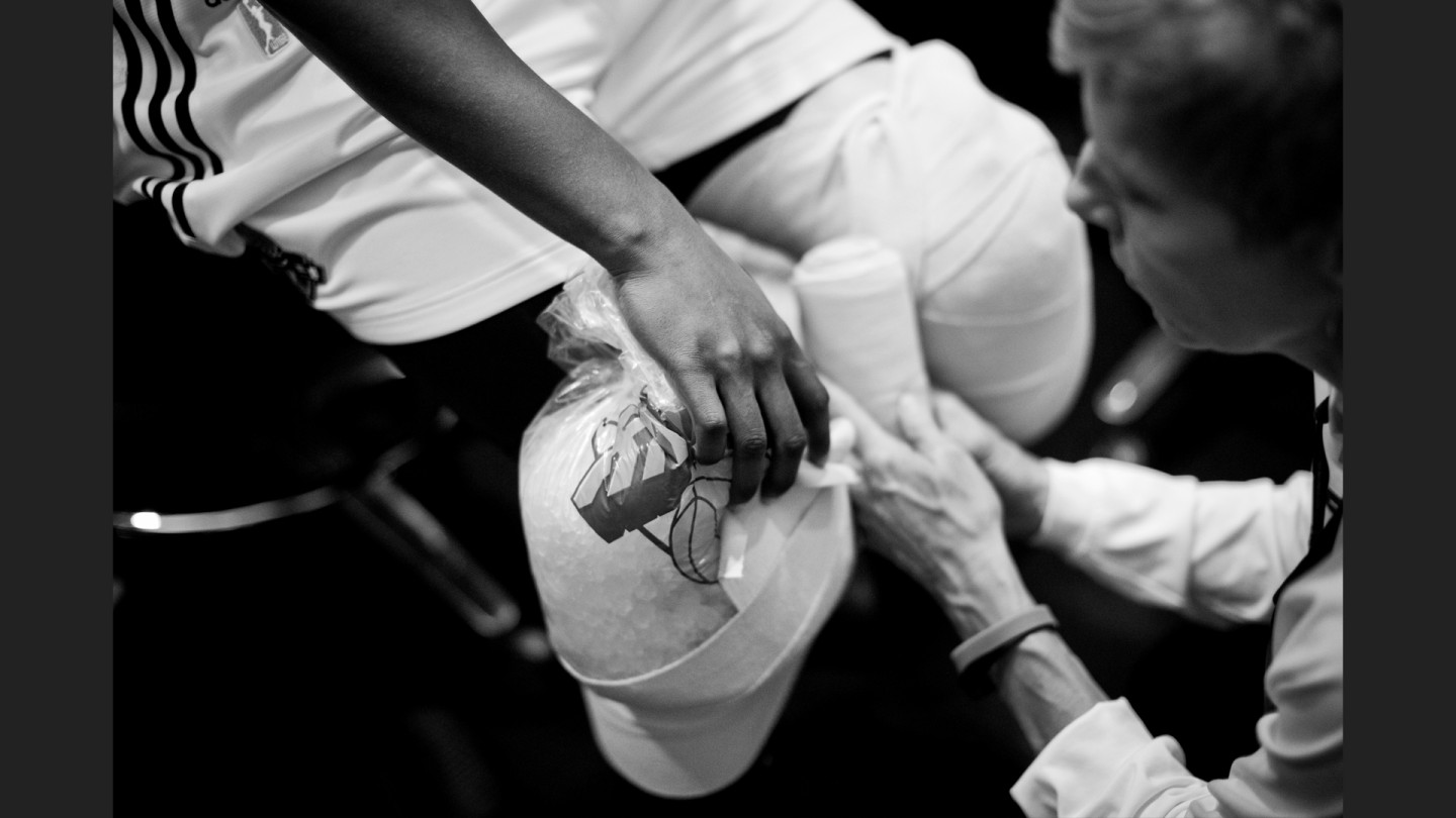 Athletic trainer Laura Ramus tends to players after their win against the Lynx.