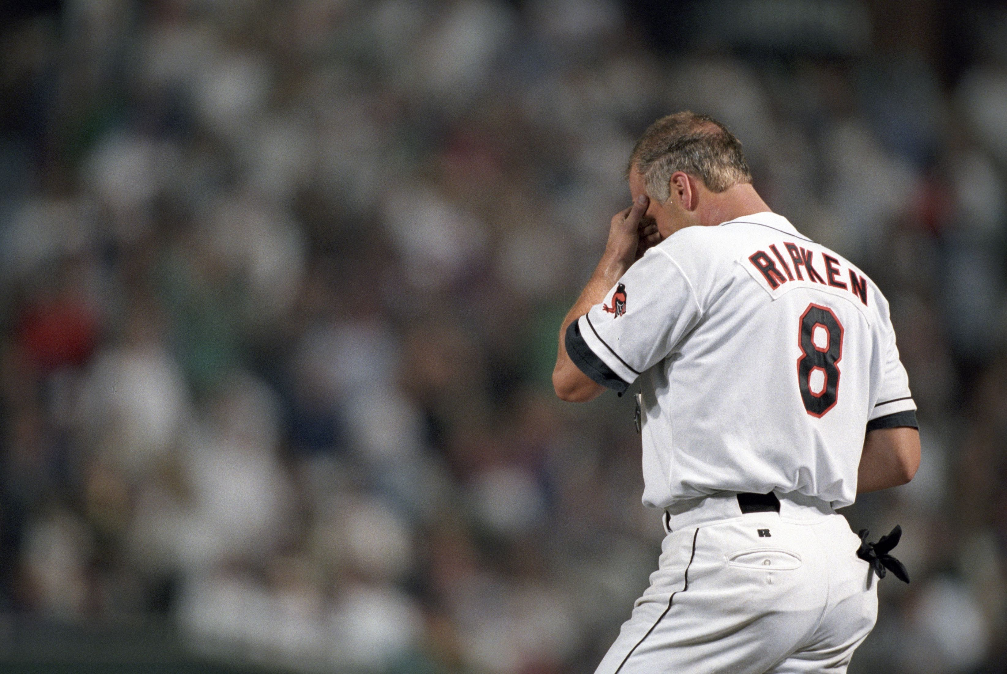 Baseball: Rear view of Baltimore Orioles Cal Ripken Jr. (8) crying during ceremony after breaking consecutive game streak during game vs California Angels. Baltimore, MD 9/6/1995 CREDIT: Walter Iooss Jr. (Photo by Walter Iooss Jr. /Sports Illustrated/Getty Images) (Set Number: X49092 TK3 R10 F12 )