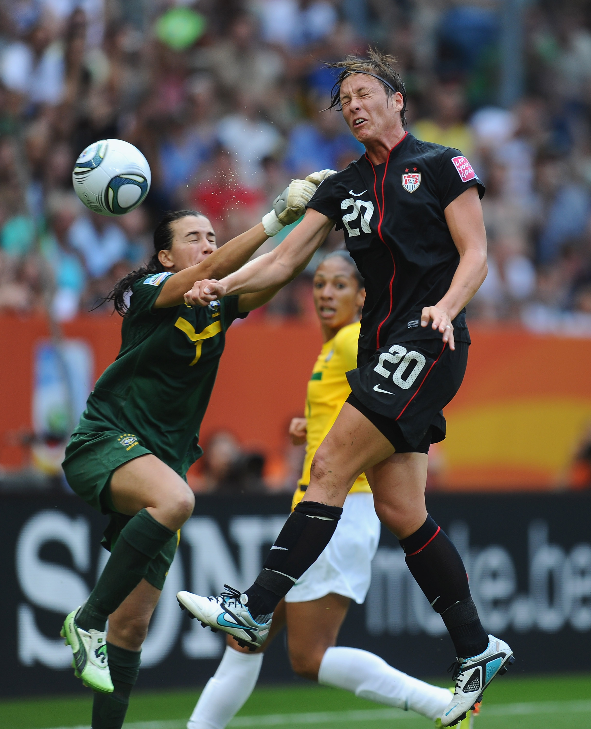 DRESDEN, GERMANY - JULY 10:  Abby Wambach of USA gets above Andreia of Brazil during the FIFA Women's World Cup 2011 Quarter Final between Brazil and USA at the Rudolf Harbig Stadium  on July 10, 2011 in Dresden, Germany.  (Photo by Mike Hewitt - FIFA/FIFA via Getty Images)