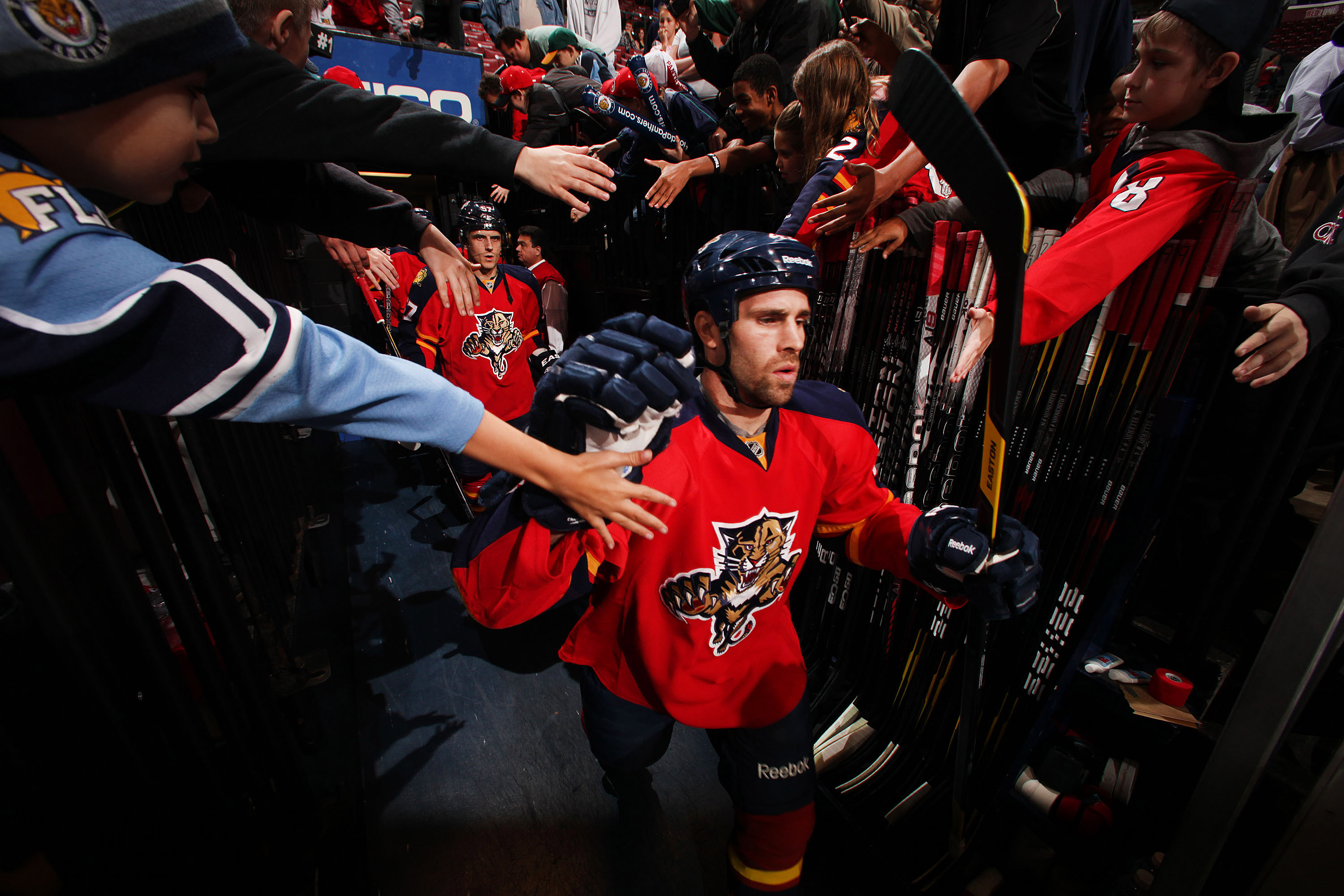 SUNRISE, FL - FEBRUARY 17: Mike Weaver #43 of the Florida Panthers is greeted by fans while heading out to the ice prior to the start of the game against the Washington Capitals and teammate Brooks Laich #21at the BankAtlantic Center on February 17, 2012 in Sunrise, Florida. (Photo by Eliot J. Schechter/NHLI via Getty Images)