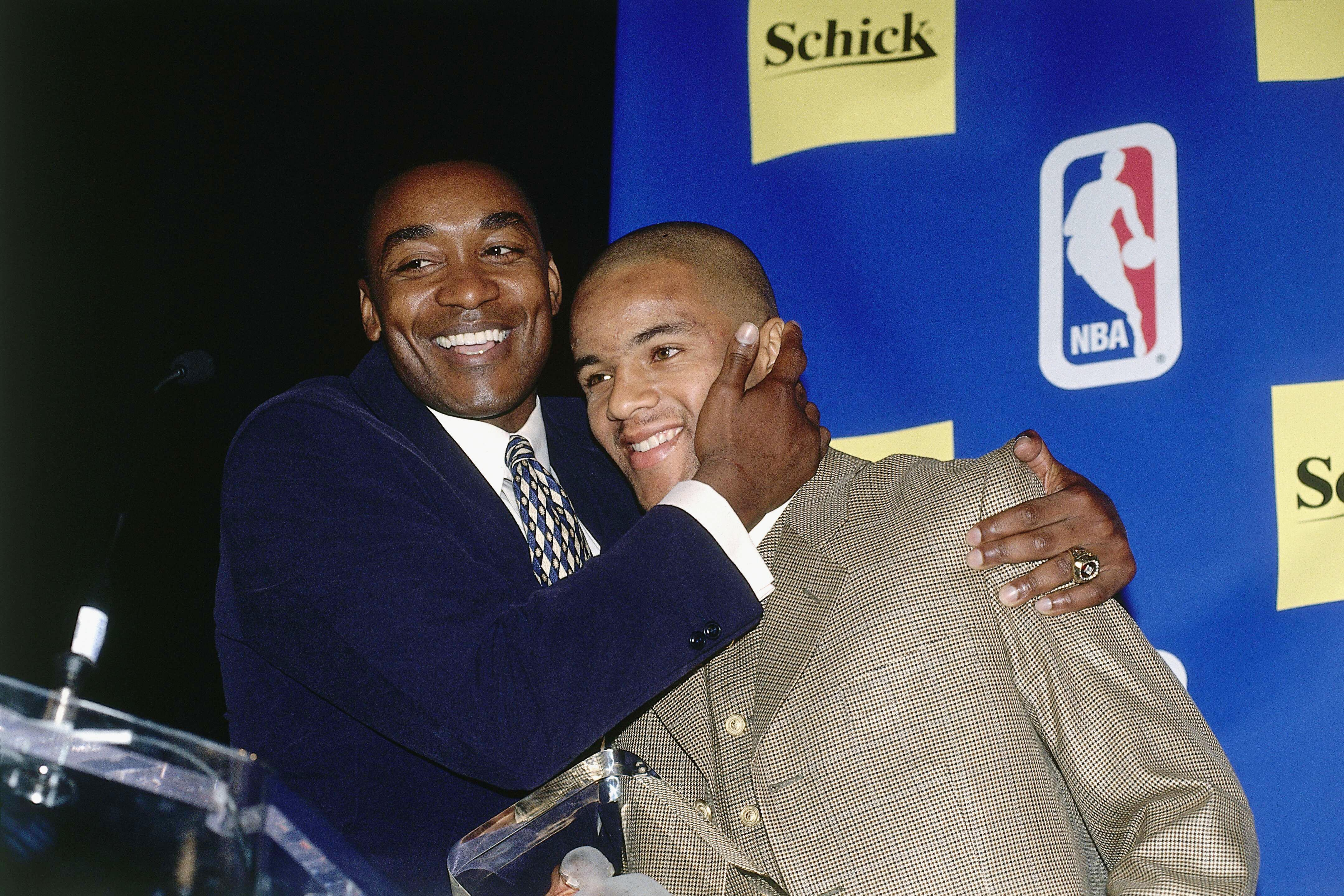TORONTO, CAN - MAY 15:  Damon Stoudamire of the Toronto Raptors poses for a portrait with Isiah Thomas during the Rookie of the Year press conference  on May 15, 1996 in Toronto, Canada.   NOTE TO USER:  User expressly acknowledges and agrees that, by downloading and/or using this Photograph, User is consenting to the terms and conditions of the Getty Images License Agreement. Mandatory Copyright Notice:  Copyright 1996 NBAE (Photo By Ron Turenne/NBAE via Getty Images.