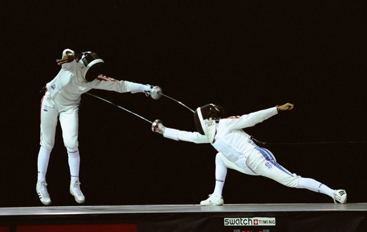 Laura Flessel of France makes a strike on Valerie Barlois of France in the womens epee final to take the gold medal  at the Atlanta-Georgia World Congress at the 1996 Centennial Olympics Games in Atlanta Georgia.