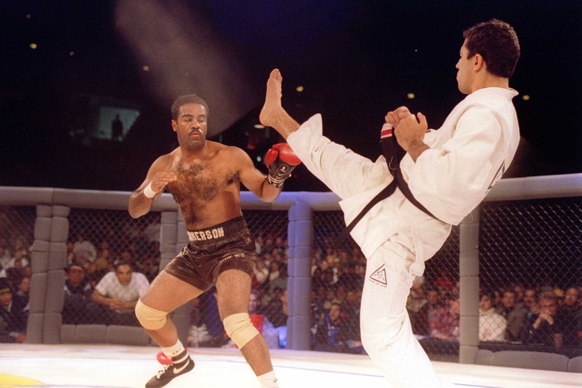 Jiu-Jitsu black belt Royce Gracie kicks at cruiserweight boxer Art Jimmerson during a 1st round match in the Ultimate Fighter Championships in Denver, Colorado. Gracie went on to win the match and eventually the championship. Mandatory Credit: Markus Boes