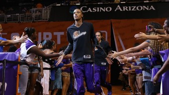 PHOENIX, AZ - AUGUST 16:   DeWanna Bonner #24 of the Phoenix Mercury runs out onto the court before the WNBA game the against the Los Angeles Sparks at US Airways Center on August 16, 2014 in Phoenix, Arizona.  NOTE TO USER: User expressly acknowledges and agrees that, by downloading and or using this photograph, User is consenting to the terms and conditions of the Getty Images License Agreement.  (Photo by Christian Petersen/Getty Images) *** Local Caption *** DeWanna Bonner