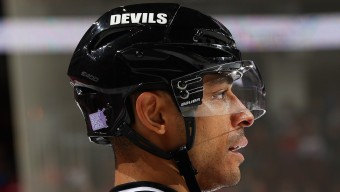 NEWARK, NJ - NOVEMBER 04: Bryce Salvador #24 of the New Jersey Devils looks on during a faceoff as the Hockey Fights Cancer logo is displyed on his helmet during the game against the the St. Louis Blues at the Prudential Center on November 4, 2014 in Newark, New Jersey. (Photo by Andy Marlin/NHLI via Getty Images)