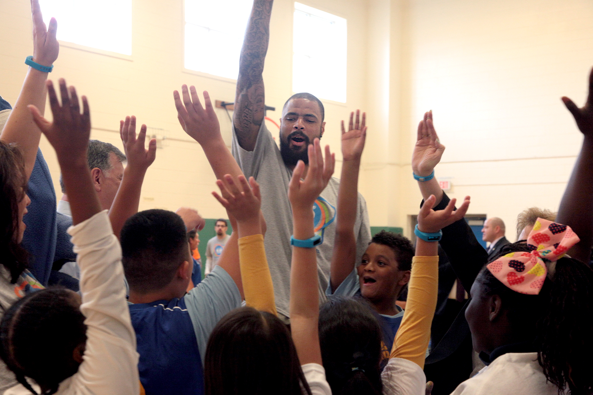 DALLAS, TX - MARCH 30:  Elementary school students getting active with UNICEF Ambassador Tyson Chandler (C) at an event celebrating UNICEF Kid Power at Esperanza Hope Medrano Elementary School on March 30, 2015 in Dallas, Texas.  (Photo by Peter Larsen/Getty Images for UNICEF)
