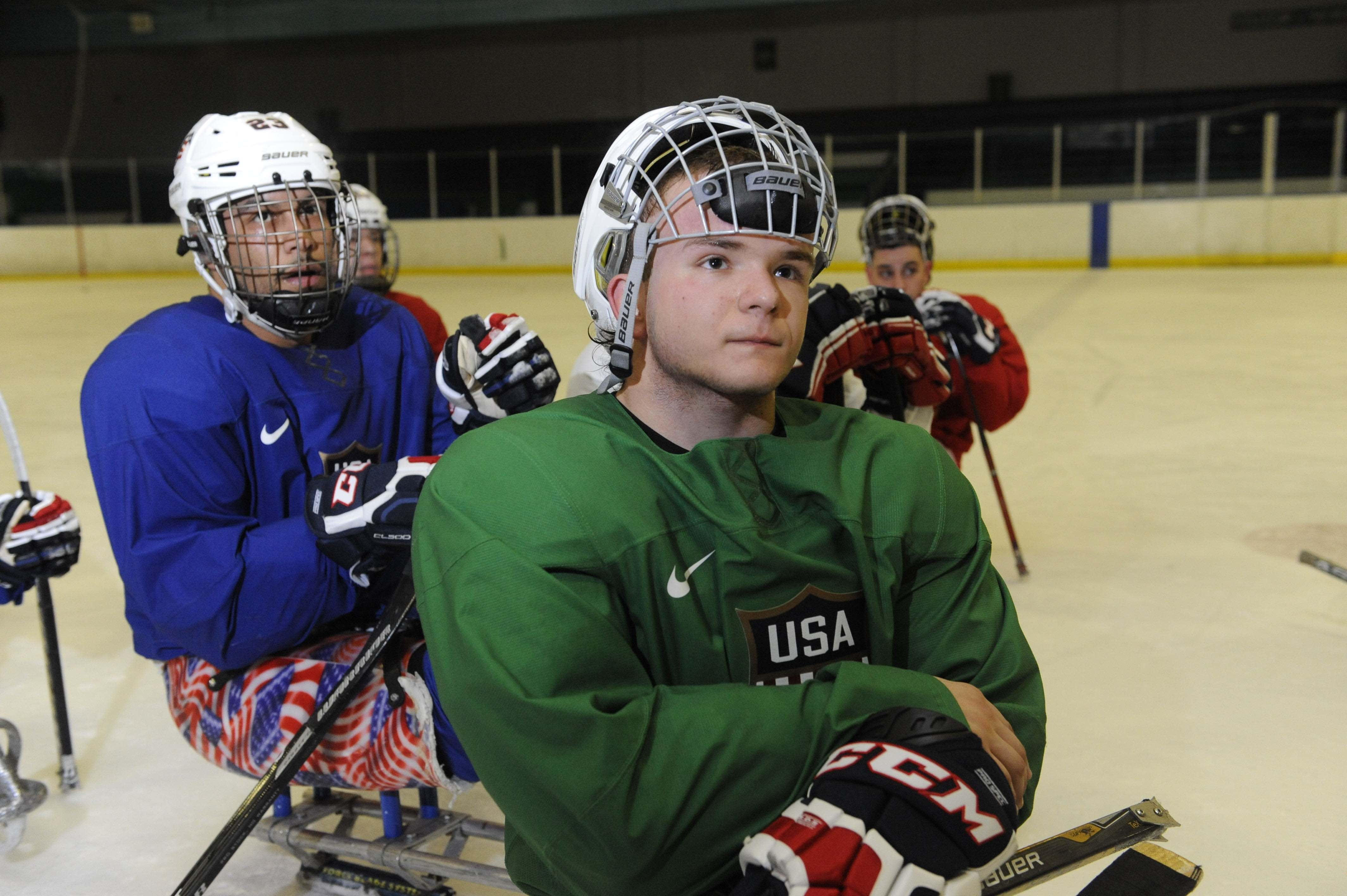 COLORADO SPRINGS, CO. FEBRUARY 27: U.S. Paralympic Sled Hockey Team athlete Josh Pauls listens to Head Coach Jeff Sauer discuss a team shooting drill while practicing at the Sertich Ice Arena in Colorado Springs, Colorado on February 27, 2014. The team travels to Sochi, Russia this week to begin defense of their 2010 Paralympic gold medal at the 2014 Paralympic Winter Games in Sochi, Russia. (Photo by Jason Connolly/Getty Images)