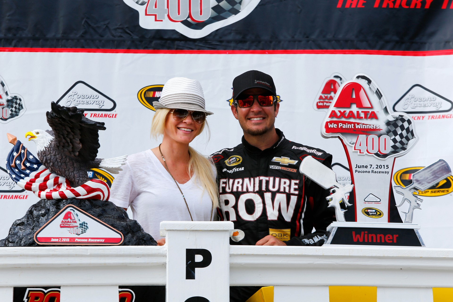 LONG POND, PA - JUNE 07:  Martin Truex Jr., driver of the #78 Furniture Row/Visser Precision Chevrolet, right, and his girlfriend, Sherry Pollex, pose in Victory Lane after Truex Jr. won the NASCAR Sprint Cup Series Axalta 'We Paint Winners' 400 at Pocono Raceway on June 7, 2015 in Long Pond, Pennsylvania.  (Photo by Jerry Markland/Getty Images)