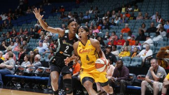TULSA, OK - JUNE 26:  Skylar Diggins #4 of the Tulsa Shock drives to the basket against Candice Wiggins #2 of the New York Liberty on June 26, 2015 at the BOK Center in Tulsa, Oklahoma.  NOTE TO USER: User expressly acknowledges and agrees that, by downloading and or using this Photograph, user is consenting to the terms and conditions of the Getty Images License Agreement. Mandatory Copyright Notice: Copyright 2015 NBAE (Photo by Shane Bevel/NBAE via Getty Images)
