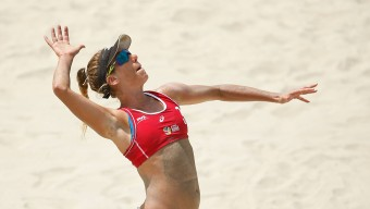 LONG BEACH, CA - AUGUST 23:  April Ross of USA serves the ball during the gold medal match against Brazil at FIVB Long Beach Grand Slam - Day 6 on August 23, 2015 in Long Beach, California.  (Photo by Joe Scarnici/Getty Images)