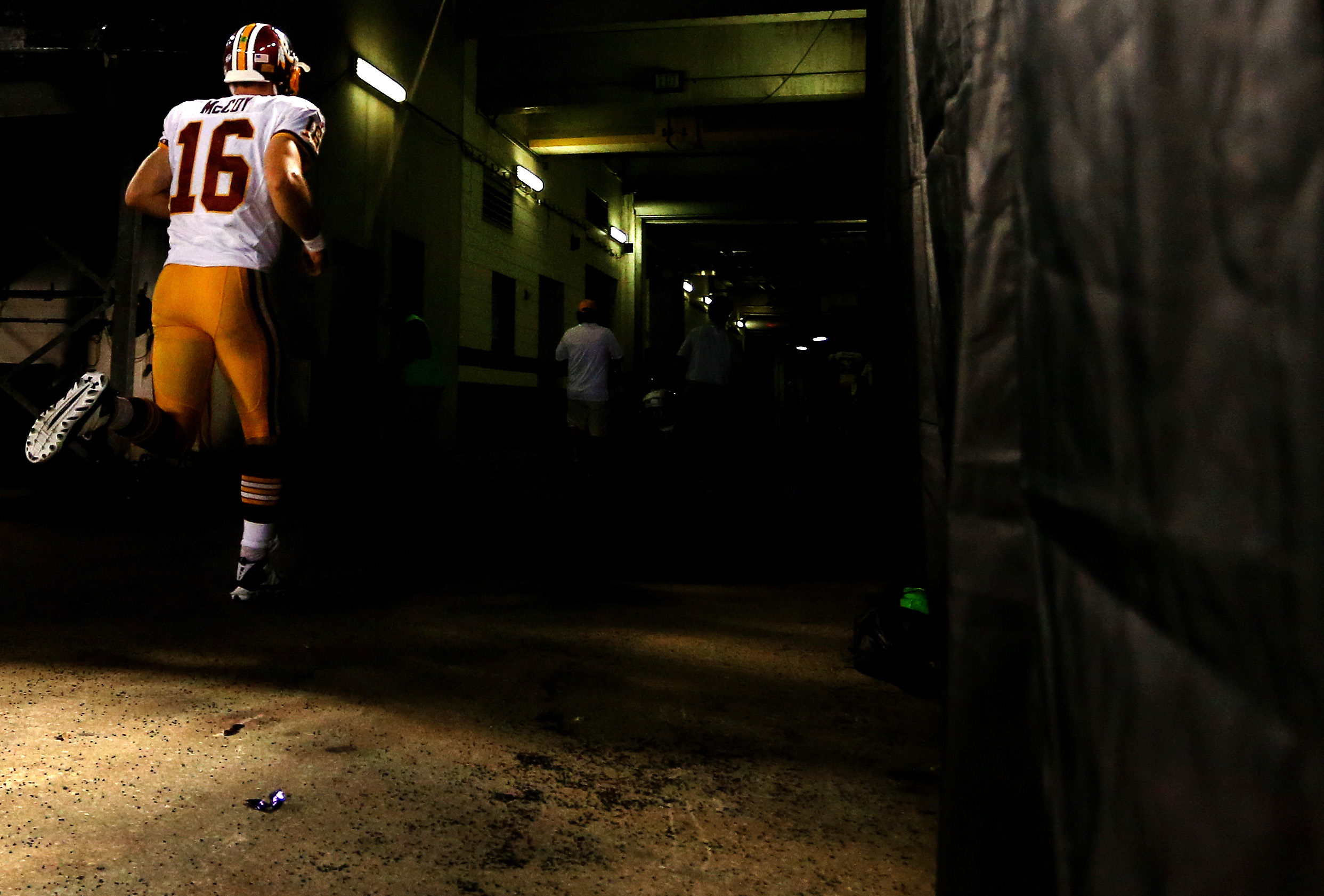 BALTIMORE, MD - AUGUST 29: Quarterback Colt McCoy #16 of the Washington Redskins runs off the field after a preseason game against the Baltimore Ravens at M&T Bank Stadium on August 29, 2015 in Baltimore, Maryland. (Photo by Matt Hazlett/ Getty Images)