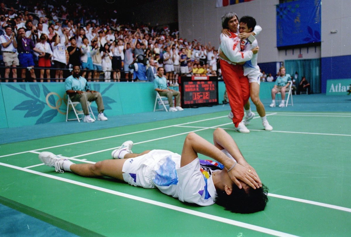 Rexy Mainaky celebrates with partner Ricky Subagja after winning the Mens Doubles in Badminton at the Georgia State University during the 1996 Olympic Games in Atlanta, Georgia.