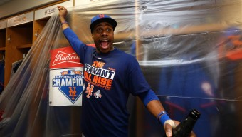 CHICAGO, IL - OCTOBER 21:  Curtis Granderson #3 of the New York Mets celebrates in the locker room with his teammates after defeating the Chicago Cubs in game four of the 2015 MLB National League Championship Series at Wrigley Field on October 21, 2015 in Chicago, Illinois.  The Mets defeated the Cubs with a score of 8 to 3 to sweep the Championship Series.  (Photo by Elsa/Getty Images)