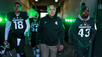 EAST LANSING, MI - NOVEMBER 28: Head coach Mark Dantonio of the Michigan State Spartans leads his team onto the field prior to a game against the Penn State Nittany Lions at Spartan Stadium on November 28, 2015 in East Lansing, Michigan. (Photo by Rey Del Rio/Getty Images)