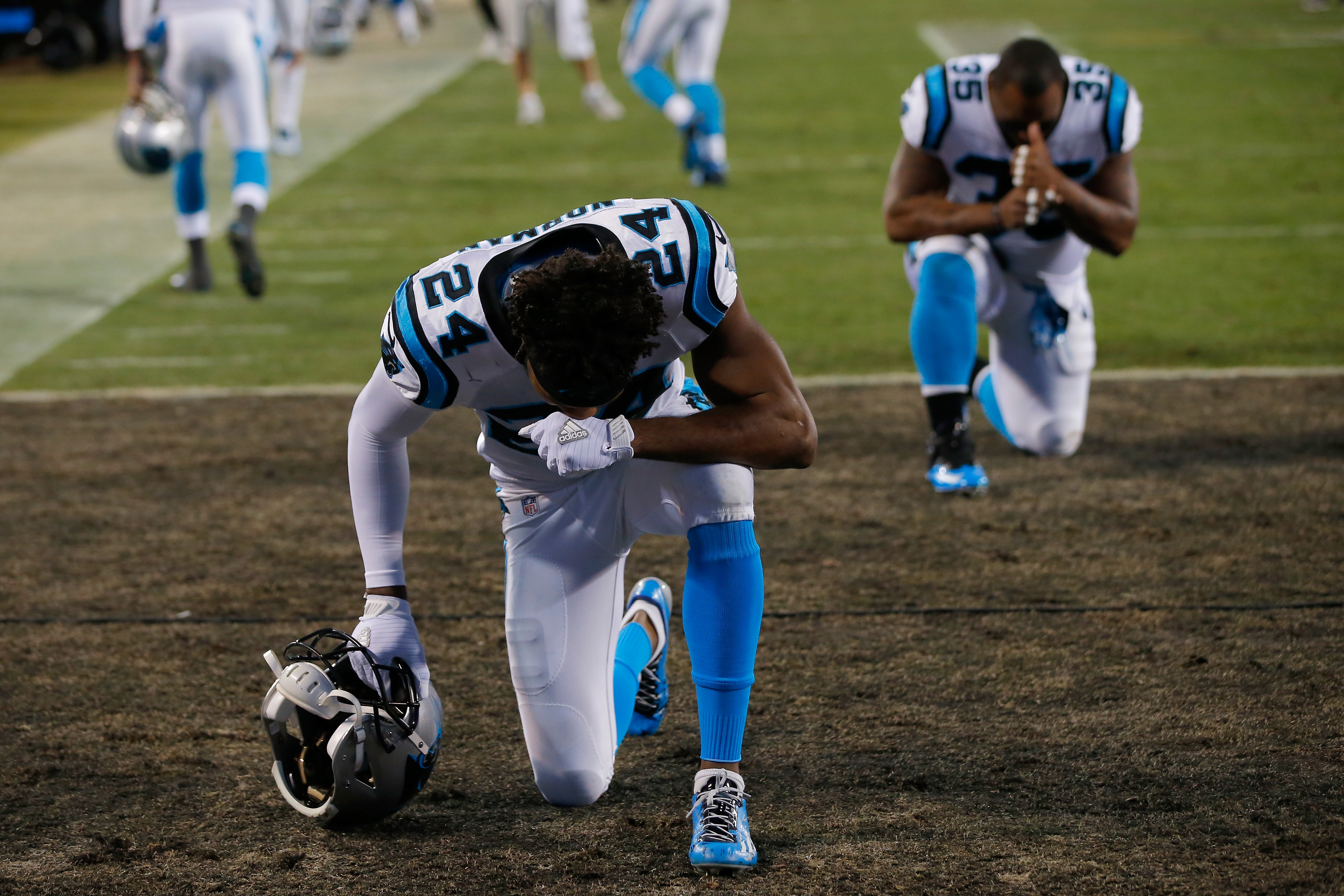 CHARLOTTE, NC - JANUARY 24: Josh Norman #24 of the Carolina Panthers and Mike Tolbert #35 kneel in the end zone prior to the NFC Championship Game against the Arizona Cardinals at Bank of America Stadium on January 24, 2016 in Charlotte, North Carolina. (Photo by Kevin C. Cox/Getty Images)