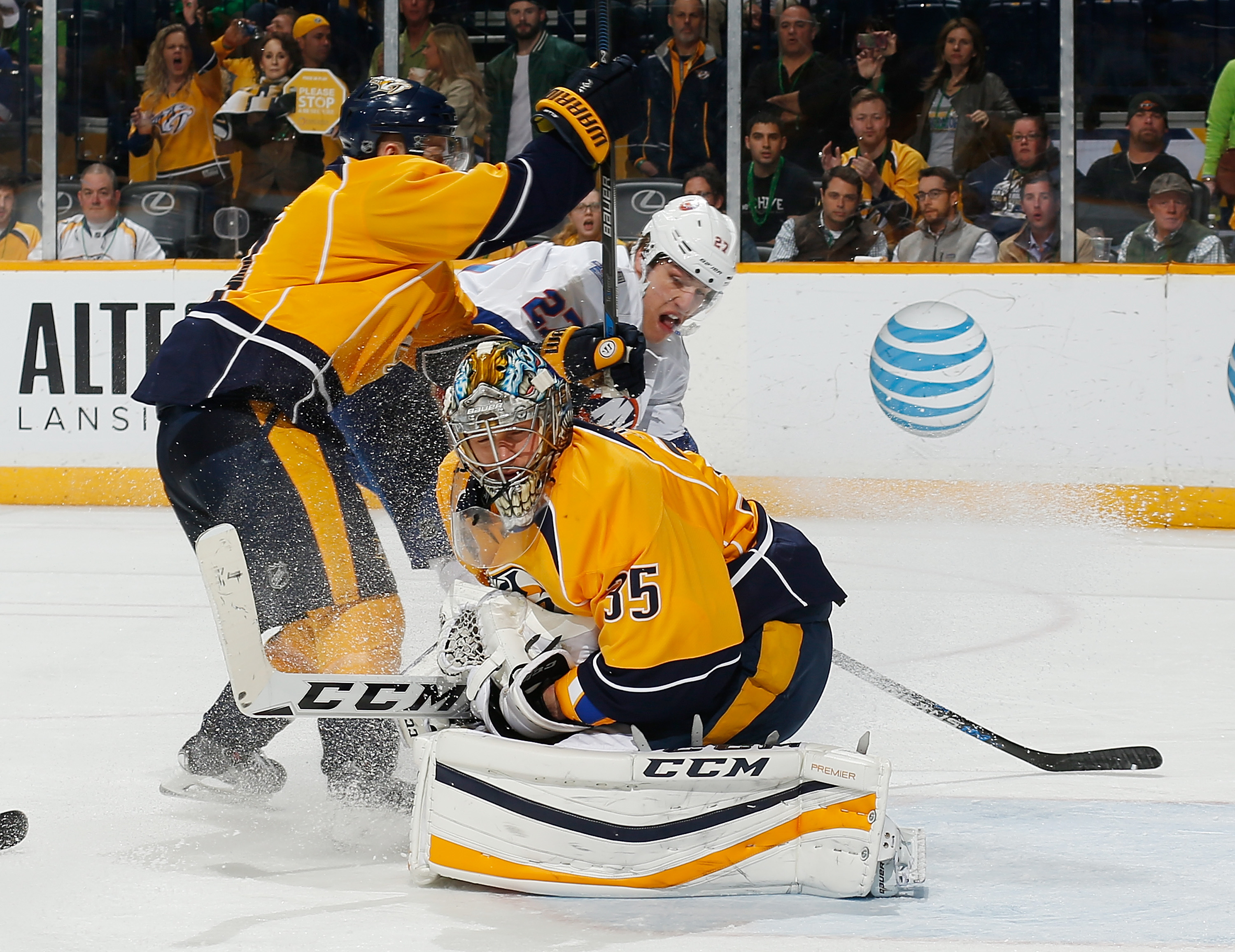 NASHVILLE, TN - MARCH 17: Pekka Rinne #35 of the Nashville Predators makes the save against Anders Lee #27 of the New York Islanders during an NHL game at Bridgestone Arena on March 17, 2016 in Nashville, Tennessee. (Photo by John Russell/NHLI via Getty Images)
