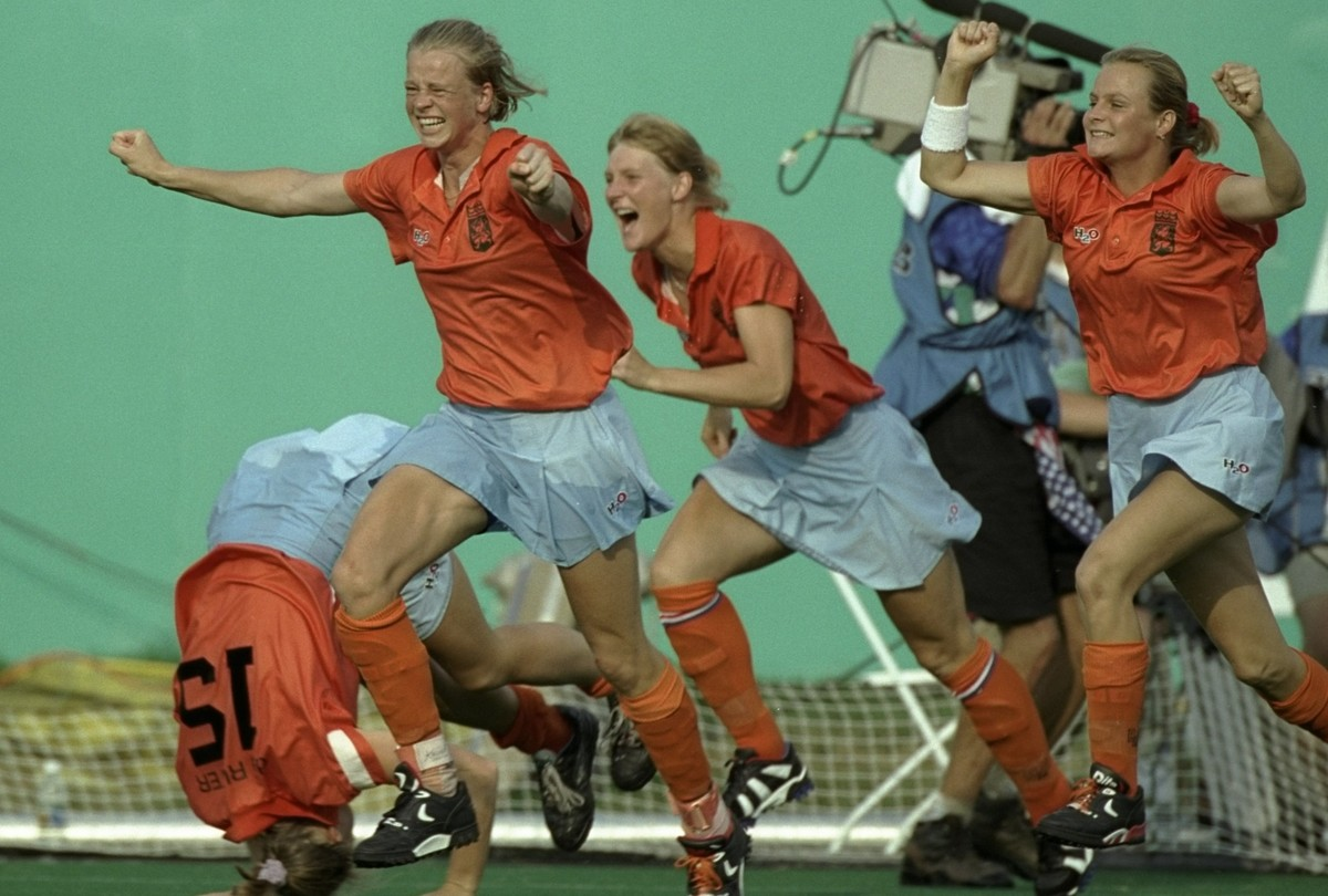 The womens hockey team from the Netherlands celebrate their penalty shoot-out victory over great Britain at Morris Brown College at the 1996 Centennial Olympic Games in Atlanta, Georgia.