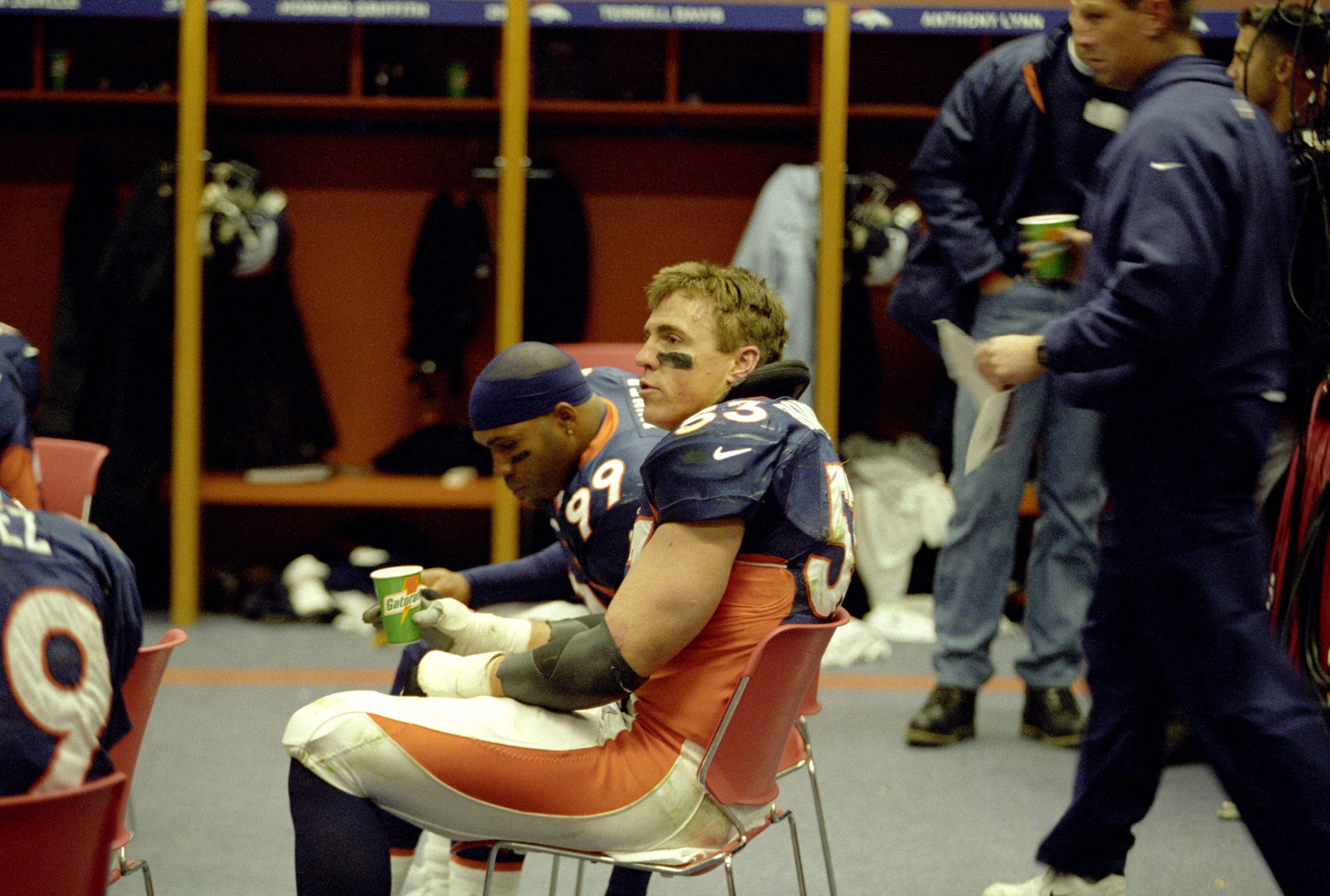 Denver Broncos linebacker Bill Romanowski (53) sita and relaxes in the locker room at halftime of the Broncos 23-10 victory over the New York Jets in the 1998 AFC Championship Game on January 17, 1999 at Mile High Stadium in Denver, Colorado. (Photo by E. Bakke/Getty Images)