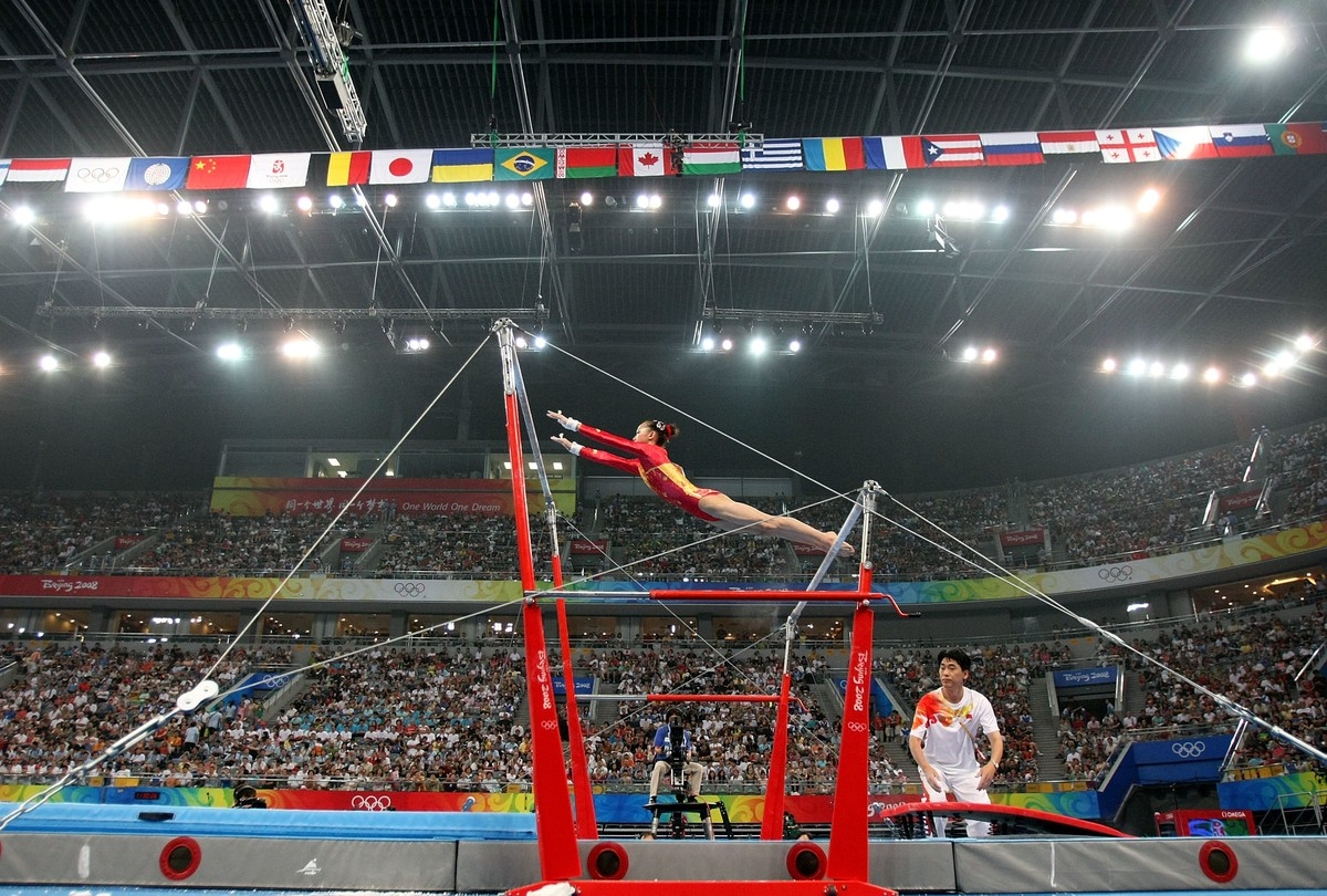 Yang Yilin of China competes on the uneven bars during qualification for the women's artistic gymnastics event held at the National Indoor Stadium during Day 2 of the 2008 Summer Olympic Games on August 10, 2008 in Beijing, China.