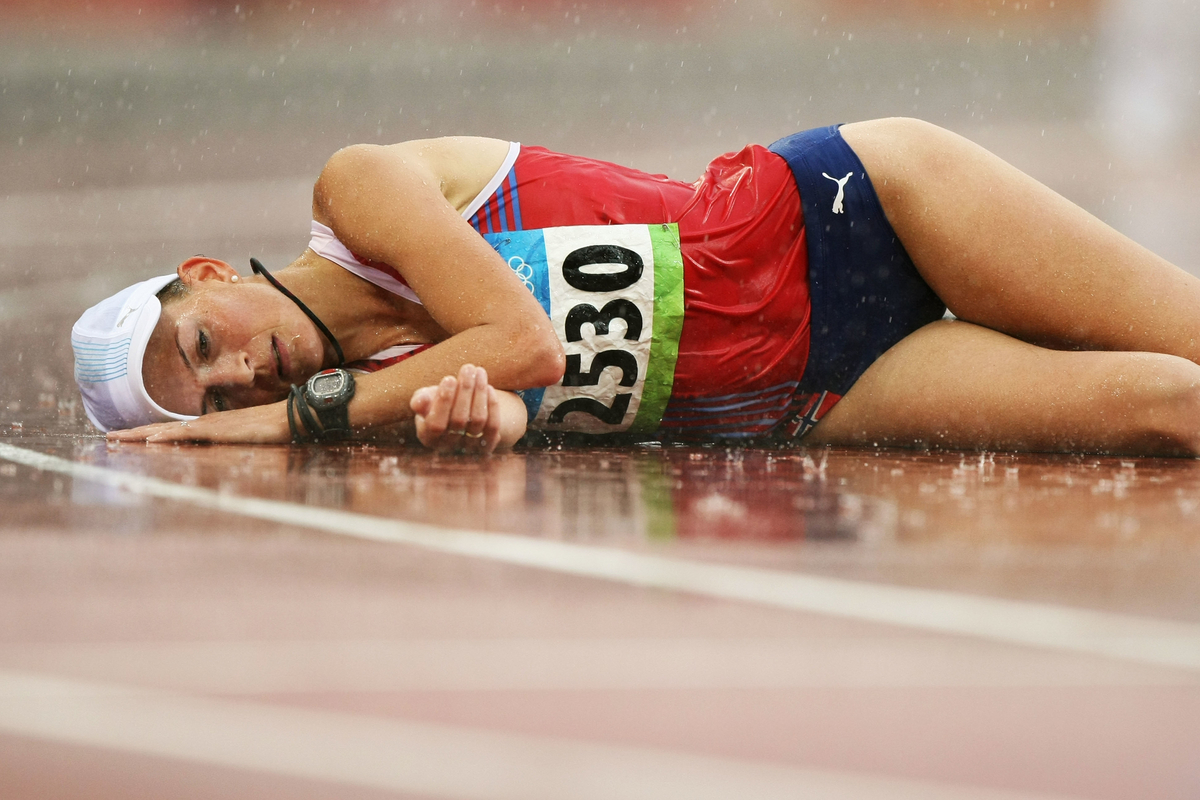 Kjersti Tysse Platzer of Norway collapses over the line in second place in the Women's 20km Walk Final and won the silver medal.  Held at the National Stadium during Day 13 of the Beijing 2008 Olympic Games on August 21, 2008 in Beijing, China.