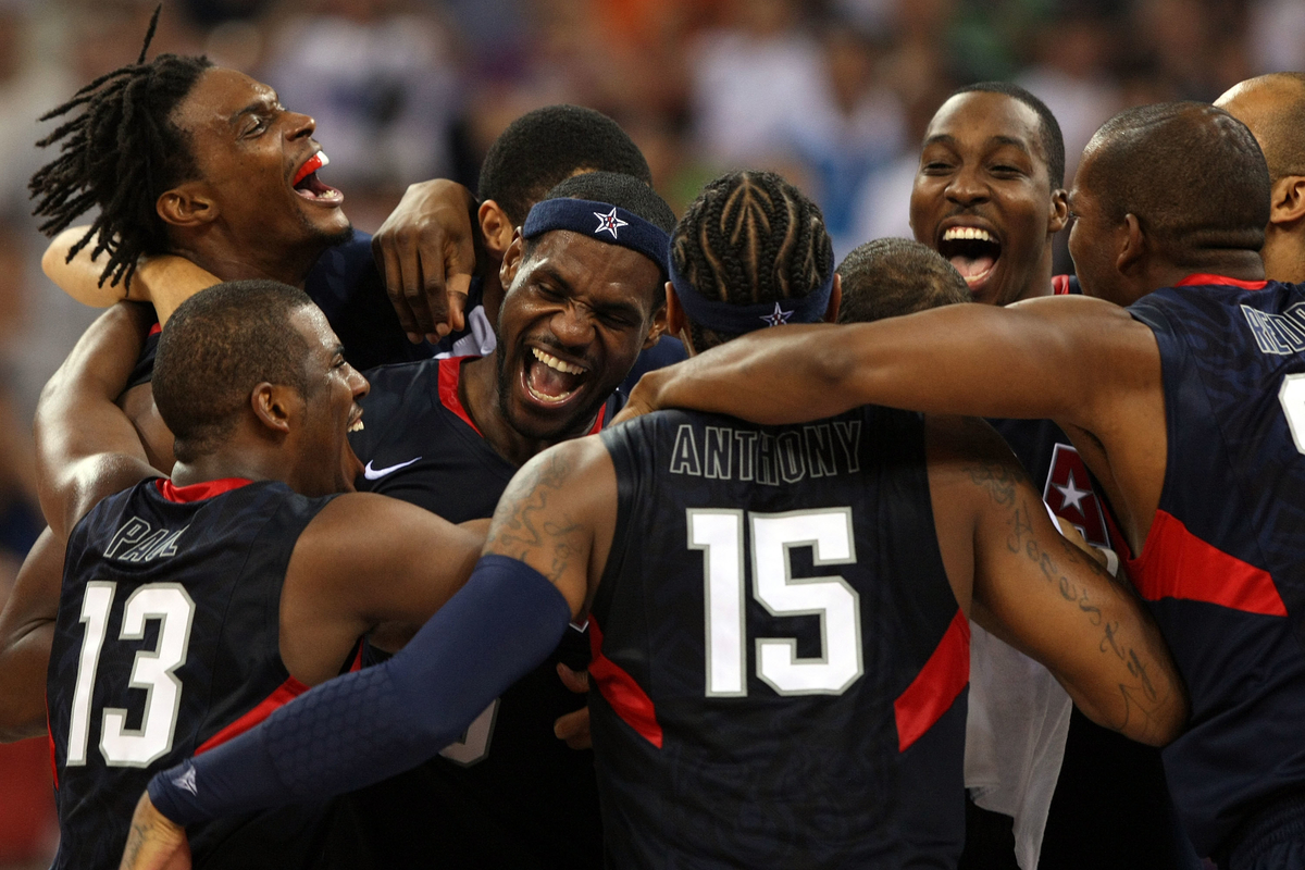LeBron James of the United States celebrates with his teammates after defeating Spain 118-107 in the gold medal game during Day 16 of the Beijing 2008 Olympic Games at the Beijing Olympic Basketball Gymnasium on August 24, 2008 in Beijing, China.