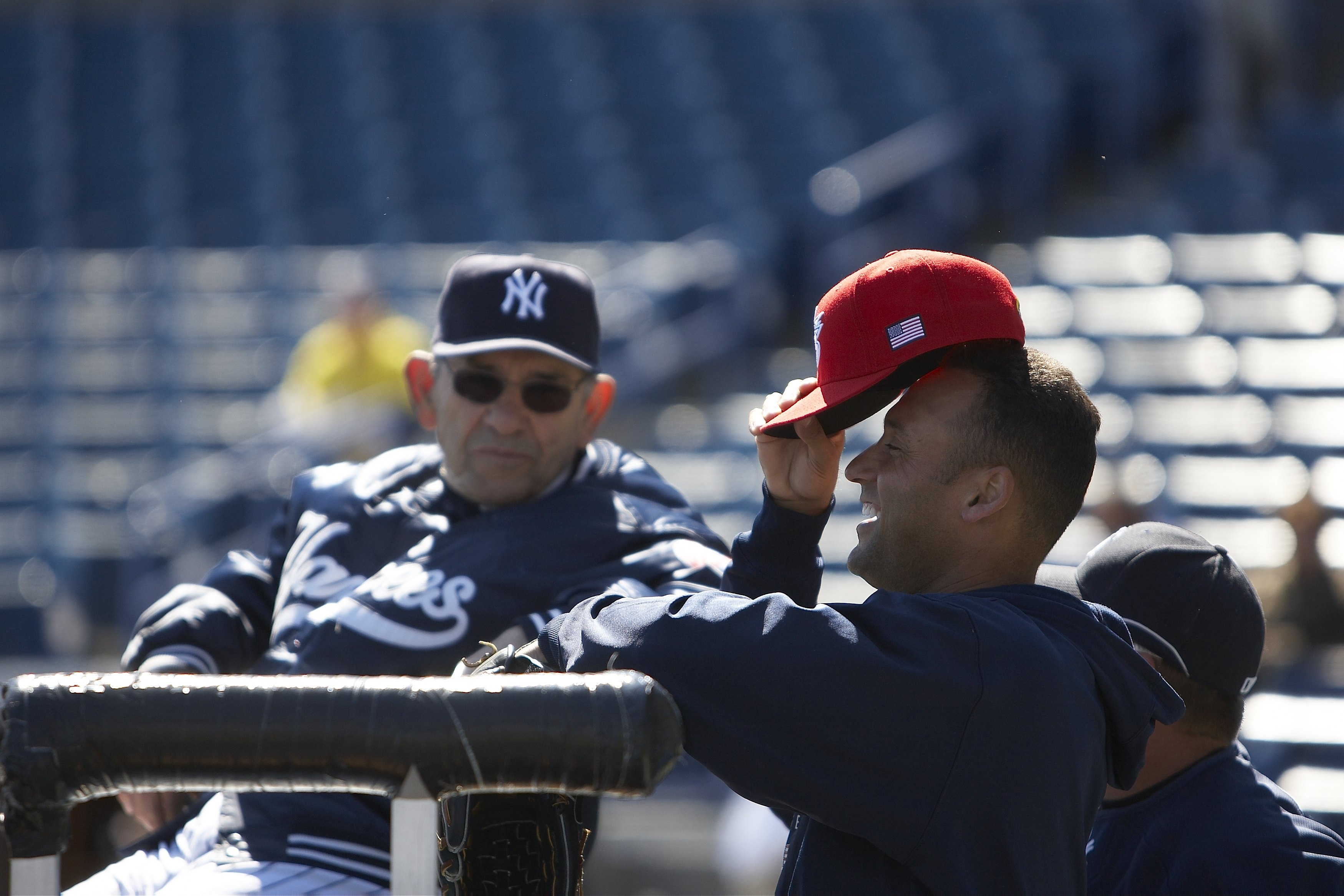 Baseball: Team USA Derek Jeter (2) with New York Yankees coach Yogi Berra before exhibition game vs New York Yankees. Tampa, FL 3/3/2009 CREDIT: Chuck Solomon (Photo by Chuck Solomon /Sports Illustrated/Getty Images) (Set Number: X81922 TK1 R4 F83 )