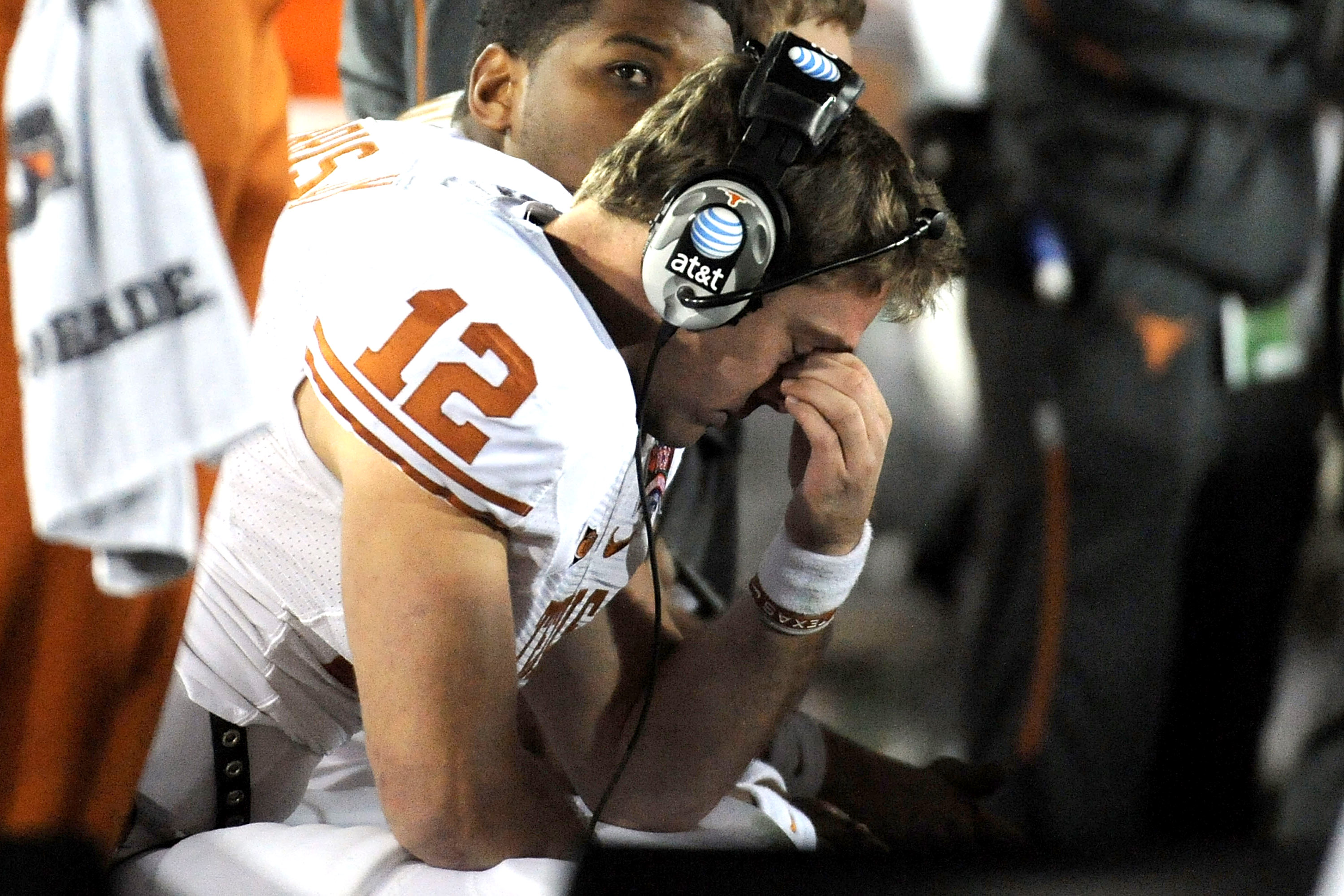 PASADENA, CA - JANUARY 07: Quarterback Colt McCoy #12 of the Texas Longhorns sits on the bench during the Citi BCS National Championship game against the Alabama Crimson Tide at the Rose Bowl on January 7, 2010 in Pasadena, California. (Photo by Harry How/Getty Images) *** Local Caption *** Colt McCoy