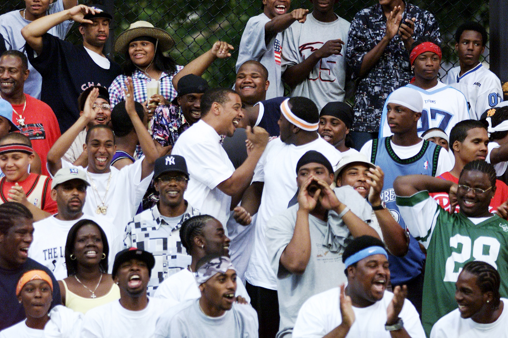 UNITED STATES - CIRCA 2000:  Fans are in the mood for action on opening day of the basketball season at Rucker Park, 155th St. and Eighth Ave.  (Photo by Corey Sipkin/NY Daily News Archive via Getty Images)