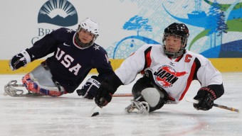 VANCOUVER, BC - MARCH 20:  Takayuki Endo #10 of Japan controls the puck against Josh Pauls #14 of the United States during the Ice Sledge Hockey Gold Medal Game on day nine of the 2010 Vancouver Winter Paralympic Games at UBC Thunderbird Arena on March 20, 2010 in Vancouver, Canada. The United States defeated Japan 2-0.  (Photo by Martin Rose/Bongarts/Getty Images)