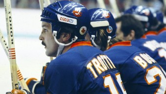 MONTREAL 1980's: Bryan Trottier #19 and Mike Bossy #22 of the New York Islanders sit on the bench in the game against the Montreal Canadiens in the 1980's at the Montreal Forum in Montreal, Quebec, Canada. (Photo by Denis Brodeur/NHLI via Getty Images)