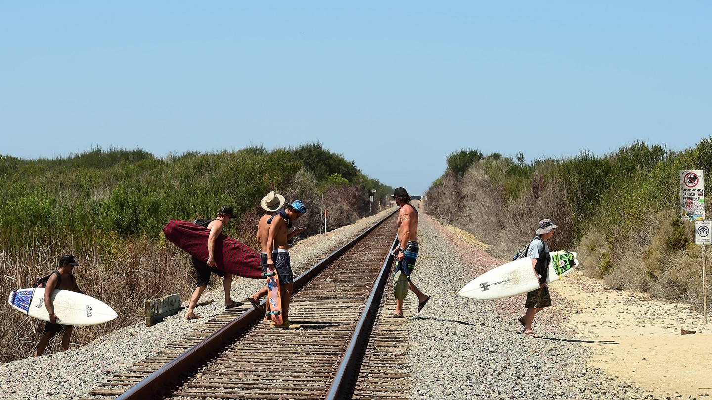 Trestles is named for the bridges that lift the railroad tracks over the stream that empties into the Pacific Ocean. Surfers walk down the trails past the freeway and over the tracks to get to the beach.