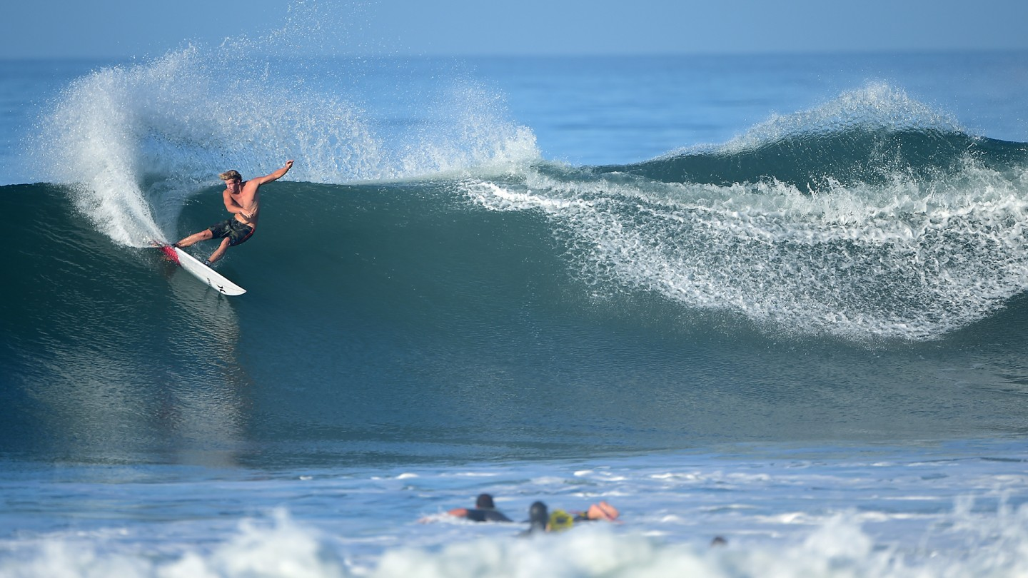 Hurley team rider John John Florence weaves a deep carve on a perfect Lowers wave.