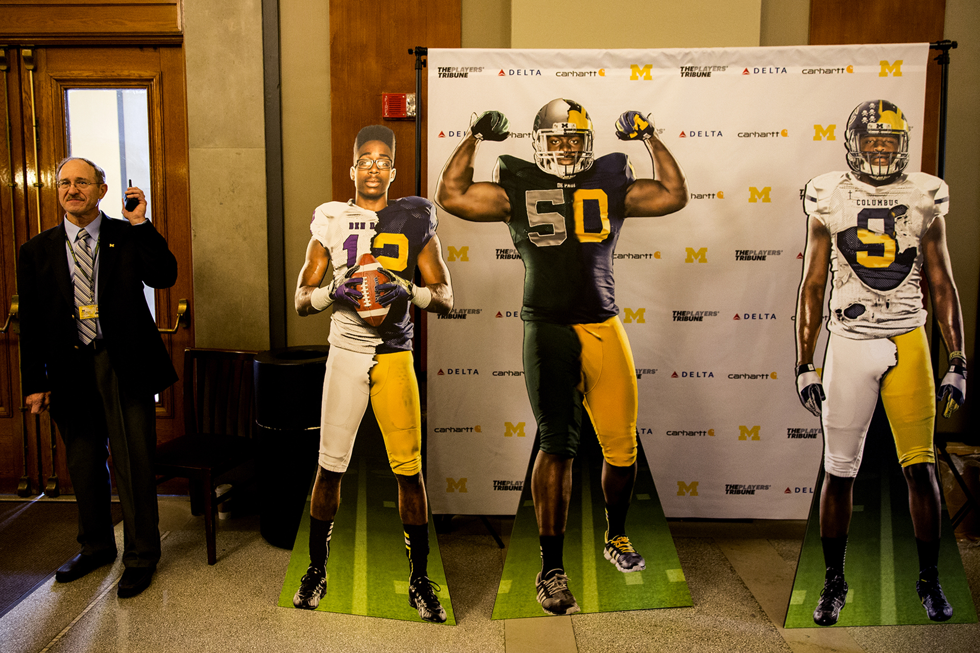 Cardboard cutouts of the Michigan signees stand in the lobby.