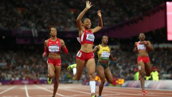 Allyson Felix celebrates after winning the 200m final during track and field at the Olympic Stadium during day 12 of the London Olympic Games in London, England, United Kingdom on August 8, 2012. (Jed Jacobsohn/for The New York Times)