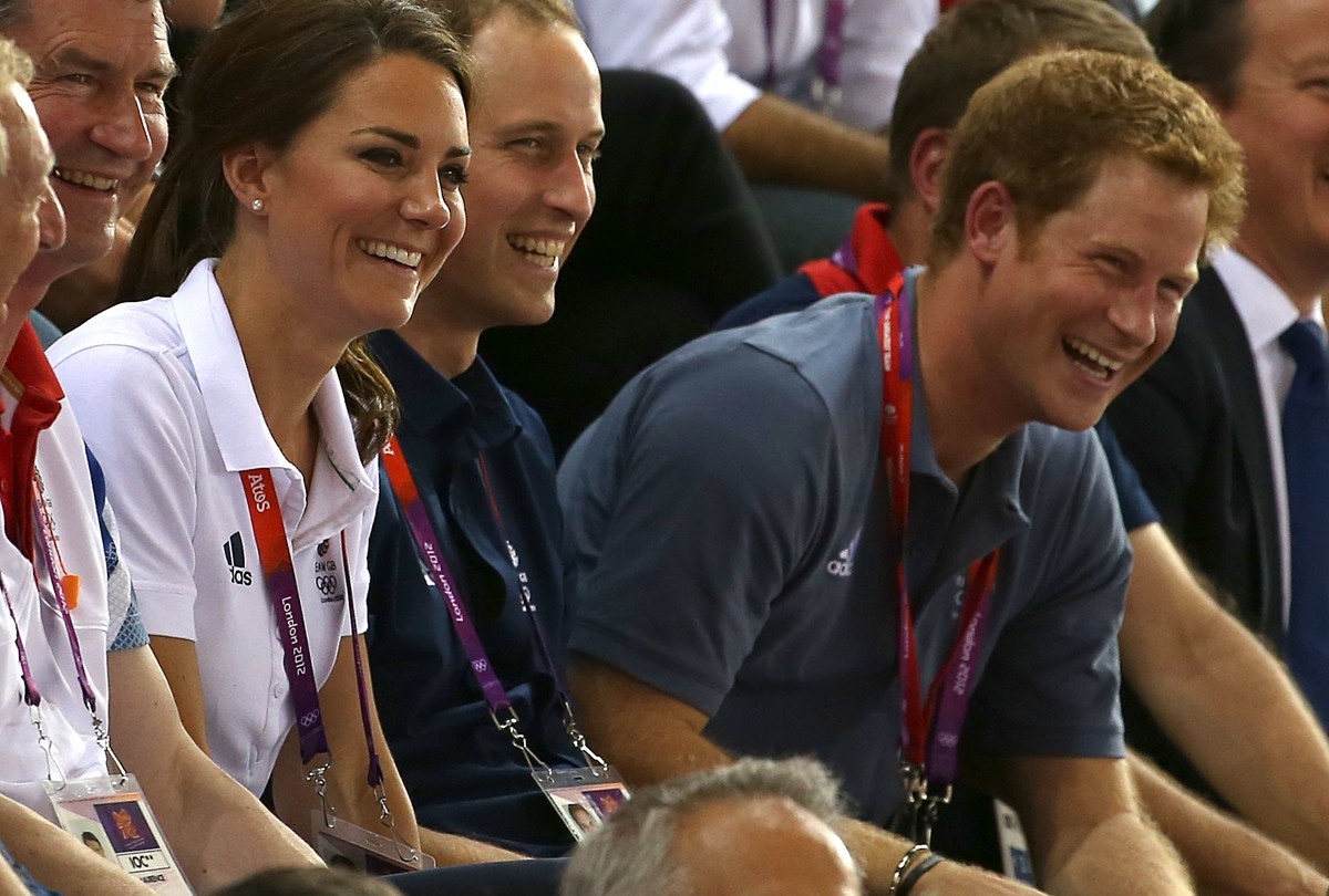 Catherine, Duchess of Cambridge, Prince William, Duke of Cambridge and Prince Harry look on during the men's cycling sprint finals at the velodrome during day 6 of the London Olympic Games in London, England, United Kingdom on August 2, 2012.