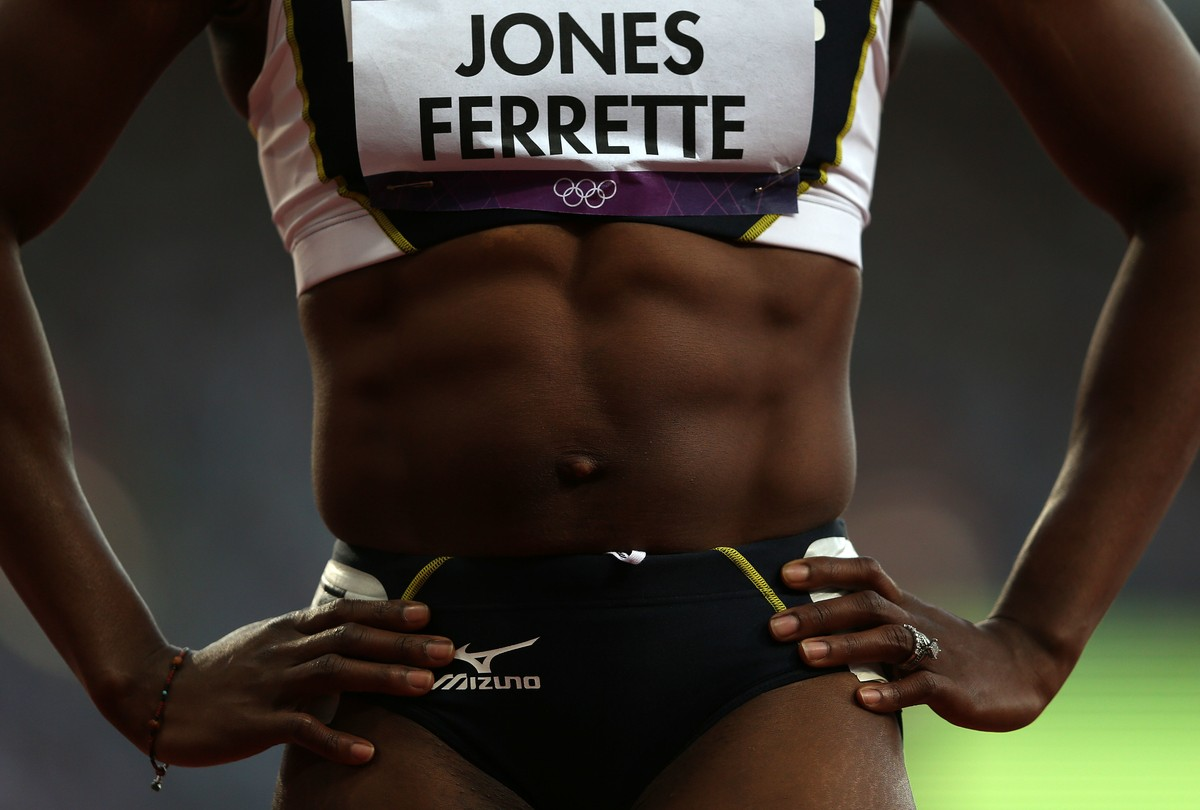 Laverne Jones-Ferrette of the US Virgin Islands looks on after a 100m heat during track and field at the Olympic Stadium during day 6 of the London Olympic Games in London, England, United Kingdom on August 3, 2012.
