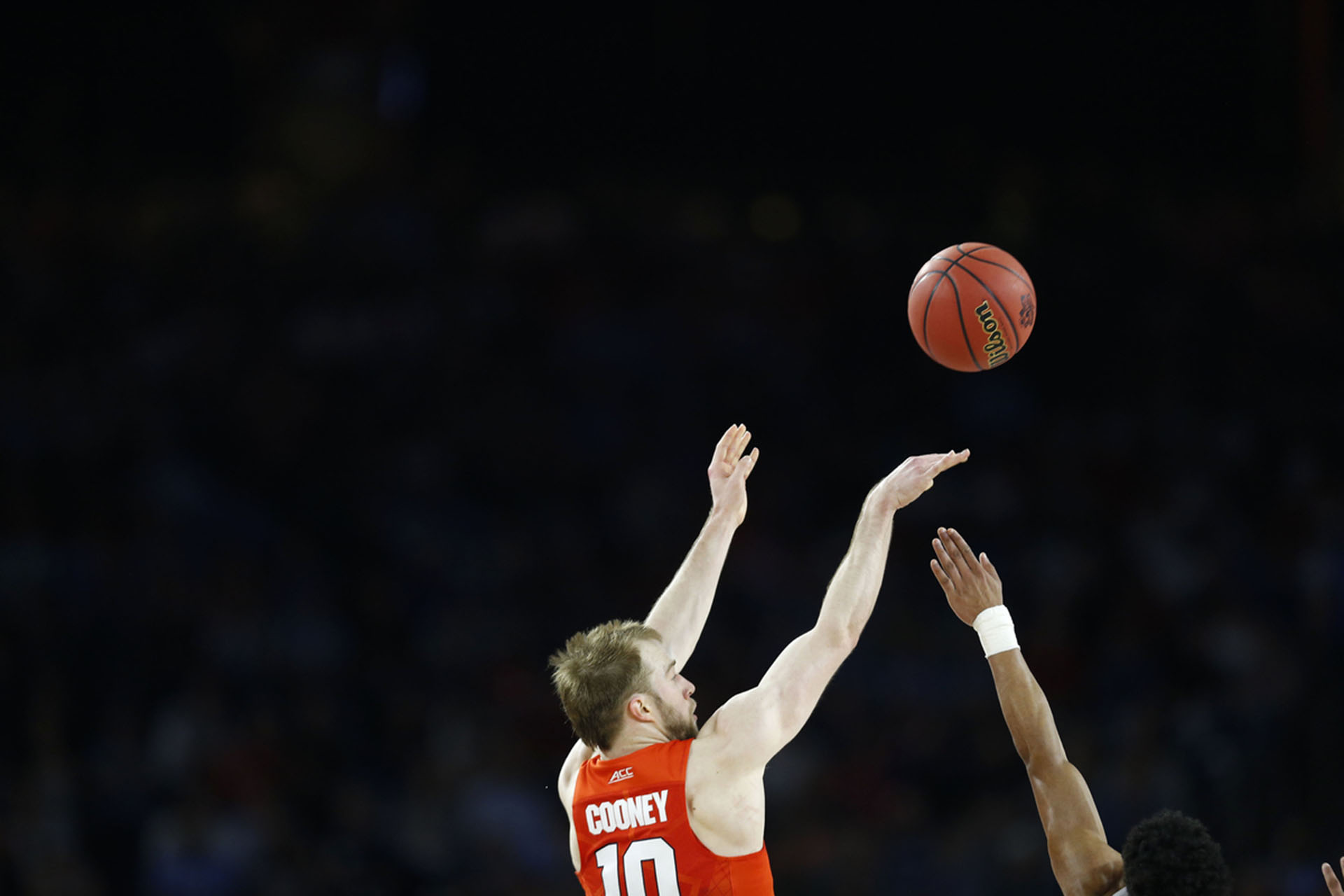 Trevor Cooney shoots a three as Syracuse takes on North Carolina on April 2, 2016 at the at NRG Stadium in Houston, Tx. (Photo by Jed Jacobsohn for the Players' Tribune)