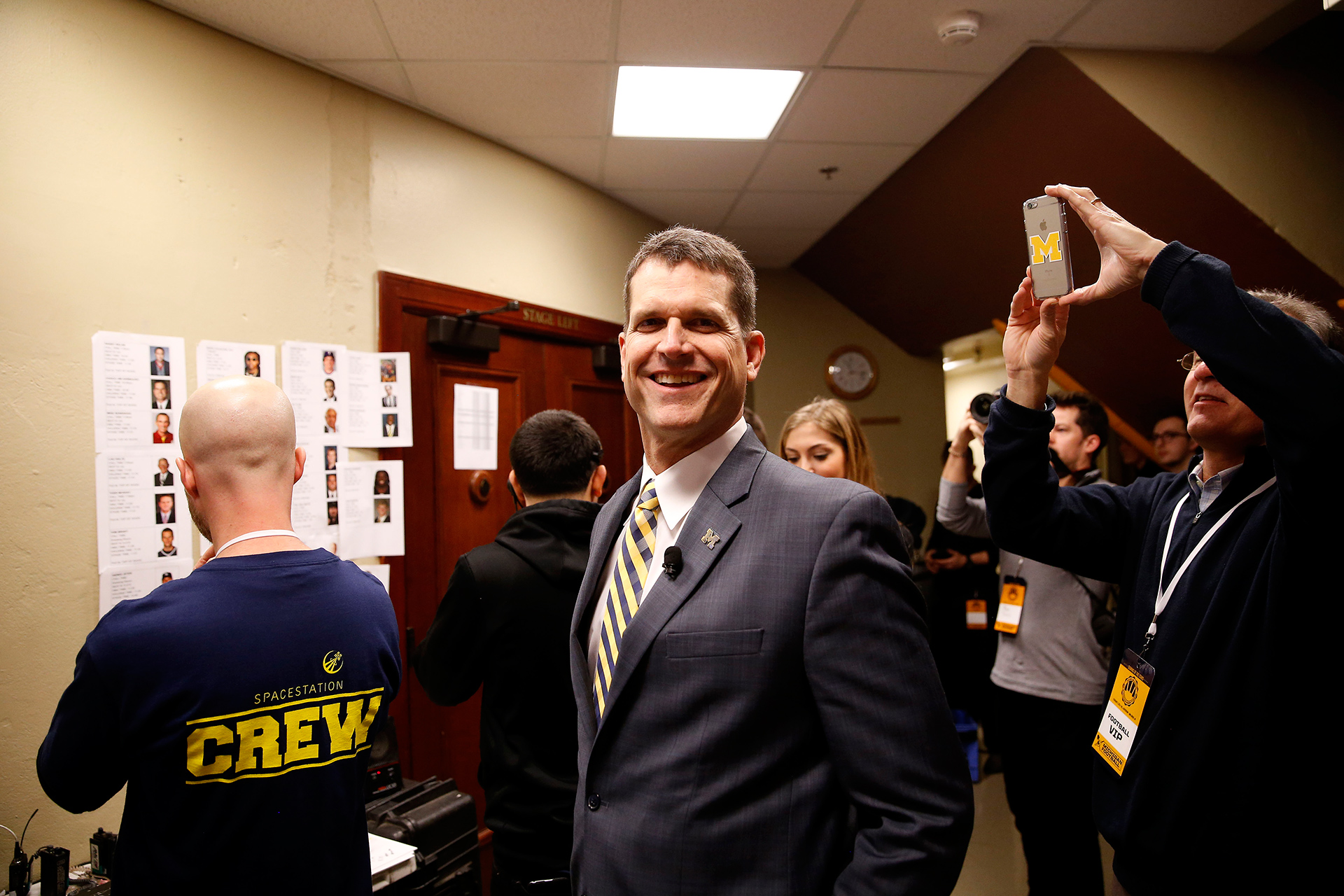 Coach Harbaugh is all smiles backstage.