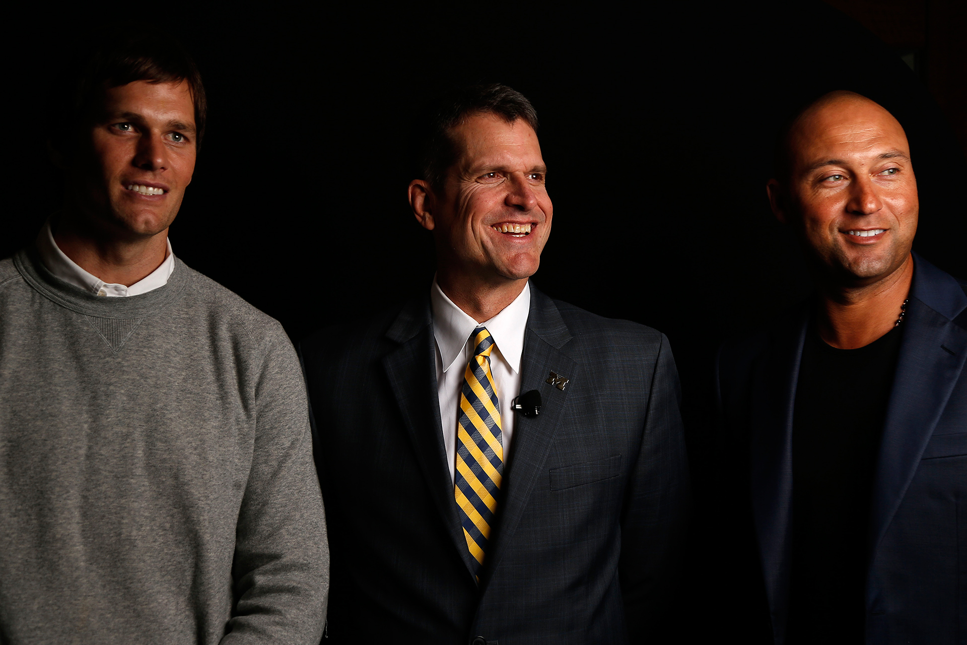 Coach Harbaugh poses for a Michigan family portrait with icons Tom Brady and Derek Jeter.