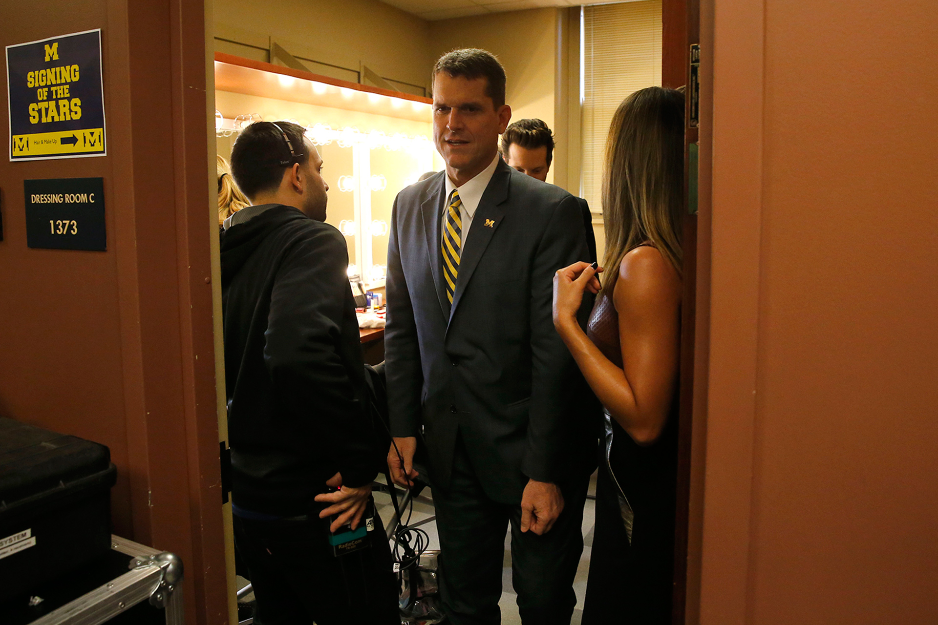 Coach Harbaugh mingles backstage.