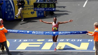 Apr 21, 2014; Boston, MA, USA; Meb Keflezighi (USA) reacts  as he crosses the finish line and wins the men's division of the 2014 Boston Marathon. Mandatory Credit: Greg M. Cooper-USA TODAY Sports