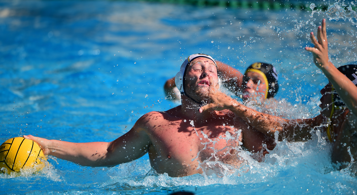 UC Irvine's Kyle Trush (#9) battles with Troy Kaltenbach of Long Beach State