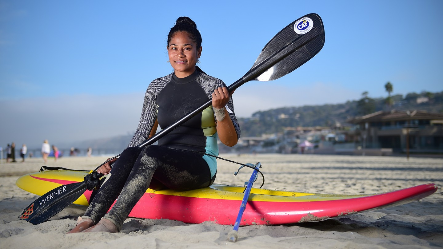 "32 year old Meira Duarte is a native of Samoa. She moved to Hawaii in 2004 and lives there with her husband and two kids. She lost the use of her legs in a 2001 car accident but wouldn't let the doctors remove them....She is striving to ""kick a ball"" someday. In the meantime she paddles canoes, participates in wheelchair marathons and.....surfs."