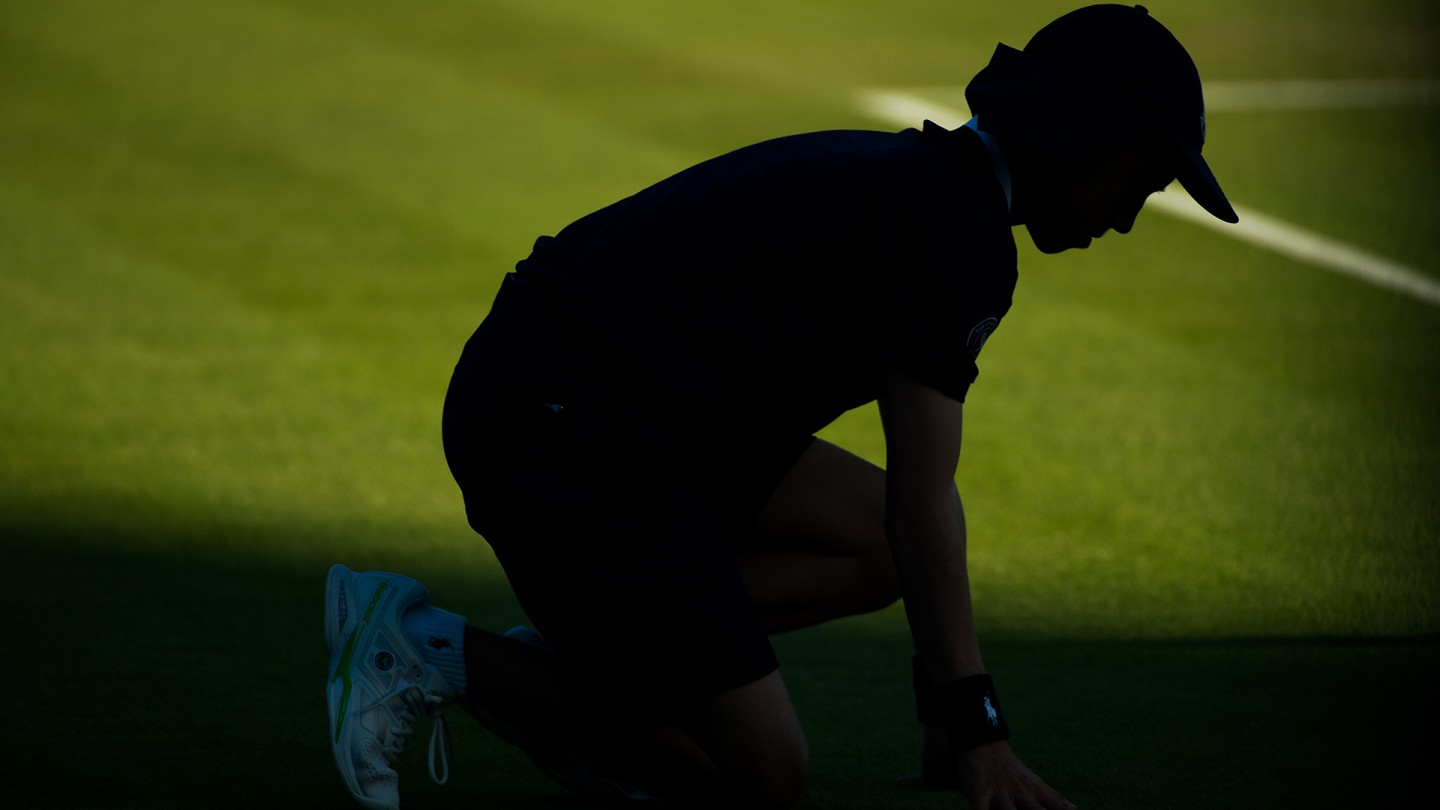 Silhouette of a ball boy on Day 2.