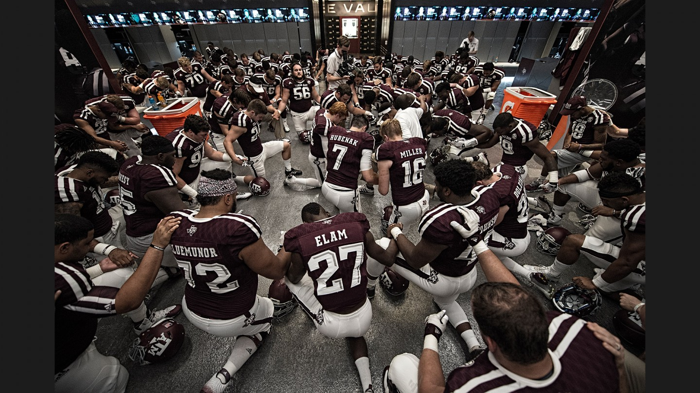 Head coach Kevin Sumlin leads the team in The Lord's Prayer before speaking to the players and taking the field against Nevada.