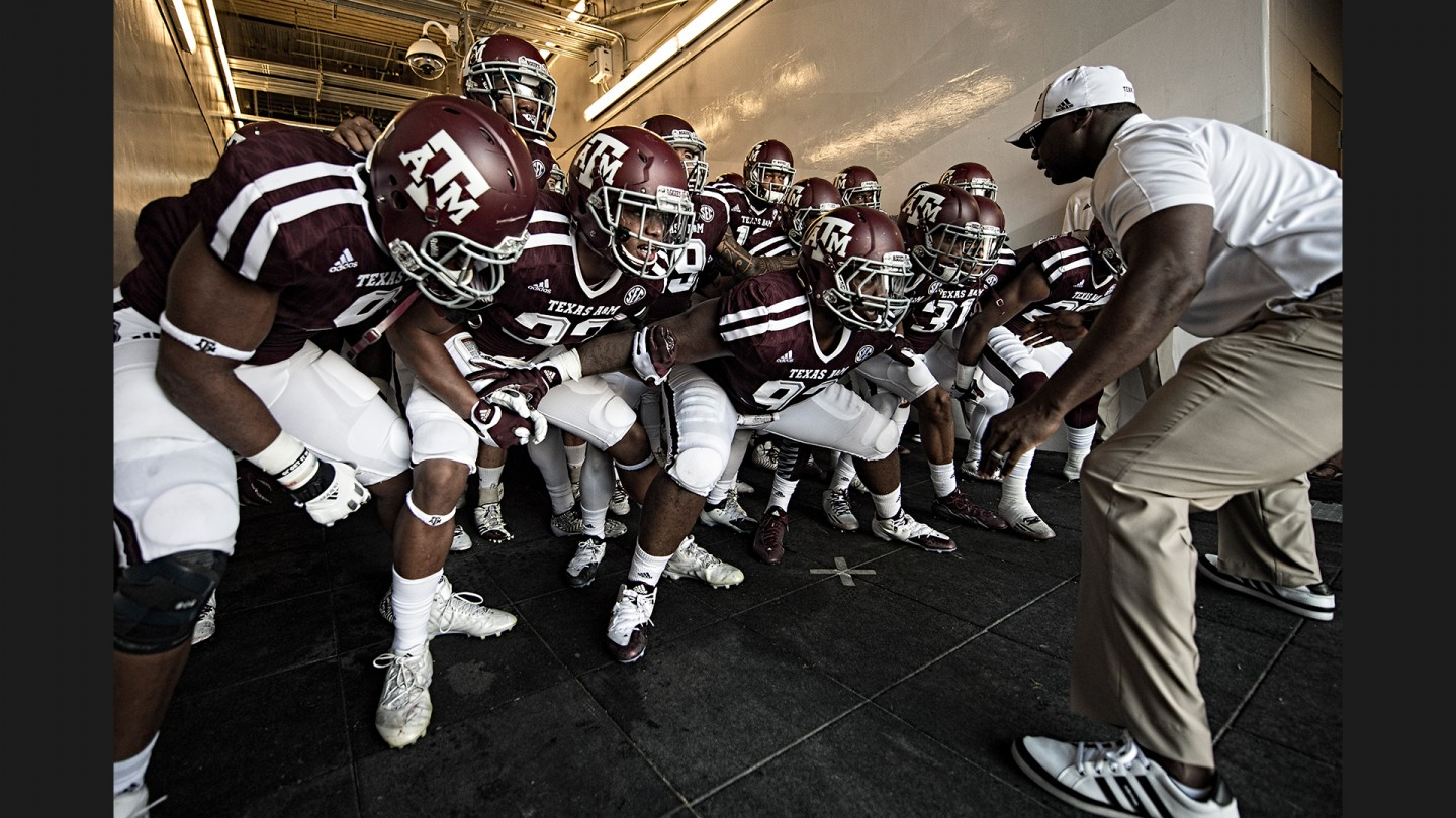 Strength and conditioning coach Larry Jackson gets the players fired up in the tunnel before running out onto the field at the recently renovated Kyle Field.