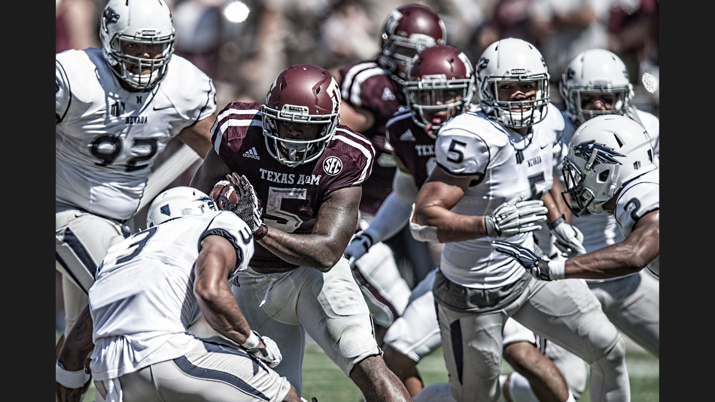 Running back Tra Carson, a transfer from Oregon in his second season with the Aggies, weaves his way through the Nevada defense on his way to a 137-yard day.